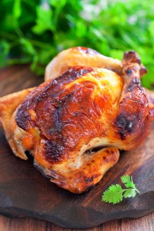 roast chicken: Yogurt marinated baked chicken, selective focus Stock Photo