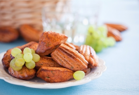 Cheese oat bran madeleines cookies with paprika and grapes. Selective focus photo