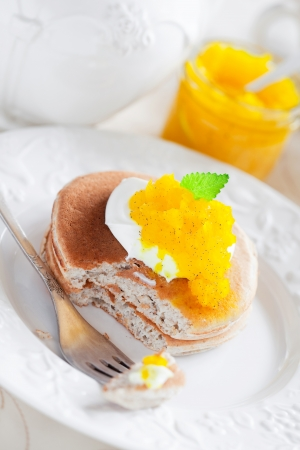 Oat pancakes with orange marmalade, selective focus Stock Photo - 15840009
