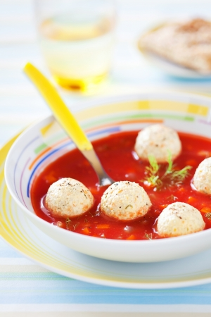 Tomato soup with vegetables and turkey meatballs, selective focus photo