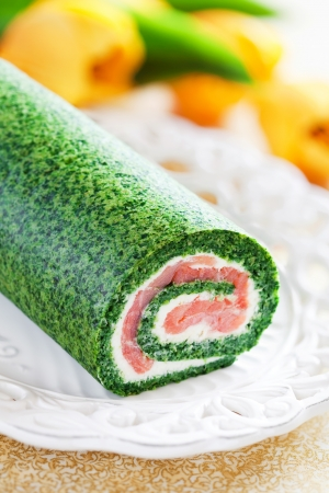 Spinach roll with smoked salmon and cream cheese, selective focus photo