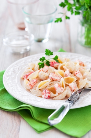 Pasta in cream sauce with crawfish, selective focus