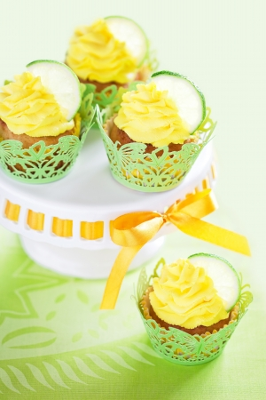 Lime cupcake with lemon cream, selective focus photo