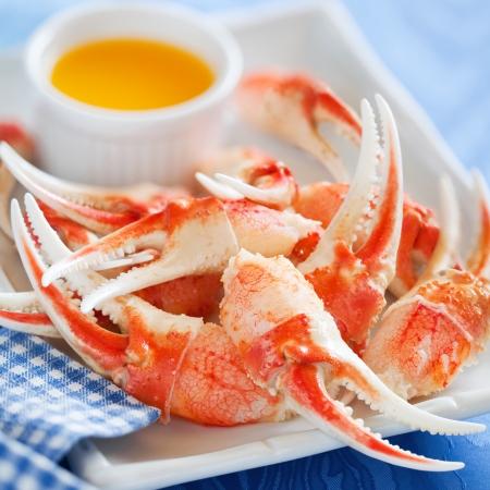 cangrejo: Pinzas de cangrejo cocidas con salsa de naranja, enfoque selectivo