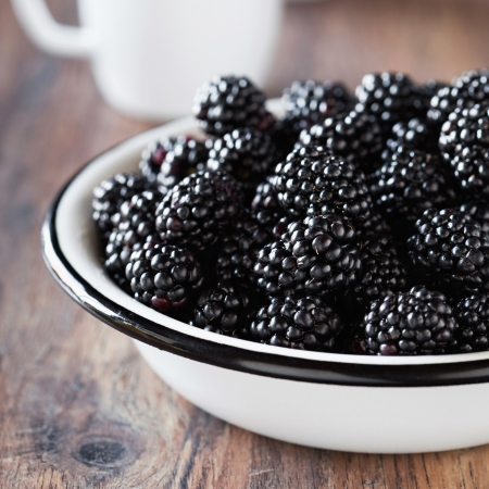 Fresh blackberries in metal bowl, selective focus