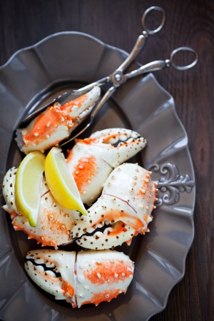 Boiled crab claws on plate, selective focus Stock Photo