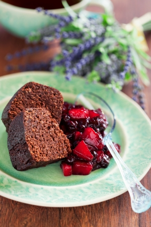 Chocolate cake with oat bran and pear-currant compote with lavender, selective focus photo