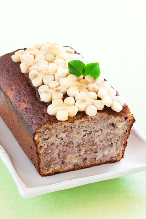 Banana bread with walnuts, selective focus photo