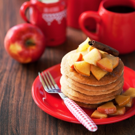 apple honey: Pancakes with cinnamon and caramelized apples, selective focus
