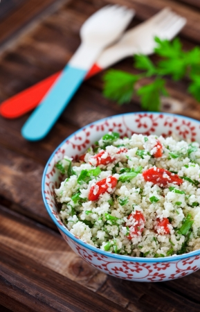 Cauliflower couscous with herbs and goji berries, selective focus