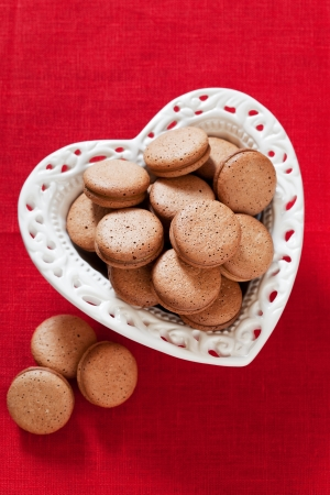Heart shaped plate with homemade cookies, selective focus photo