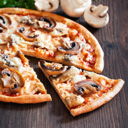 Vegetarian pizza with mushrooms, selective focus photo