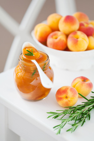 Homemade apricot jam with rosemary, selective focus