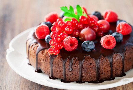 Chocolate cake with fresh berries, selective focus photo