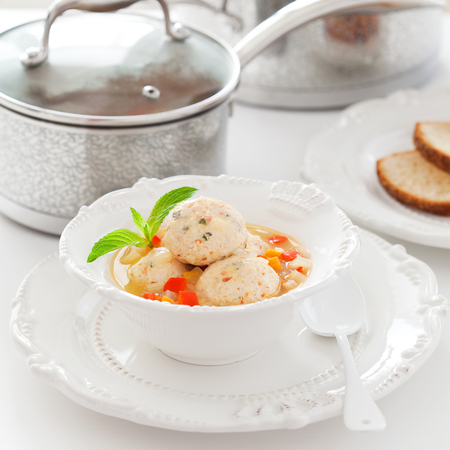 cooked pepper ball: Soup with chicken meatballs and vegetables, selective focus Stock Photo