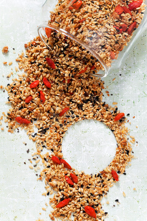flax seeds: Granola with chia seeds, flax seeds, sesame seeds and goji berries, selective focus Stock Photo