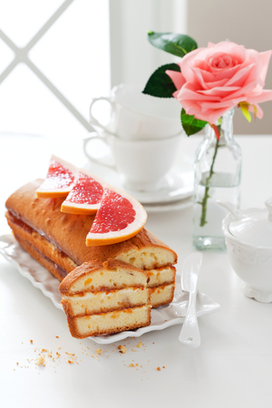 recipe decorated: Loaf cake with cream cheese and grapefruit jam, selective focus