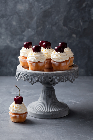 cherry: Cherry cupcakes on a cake stand, selective focus