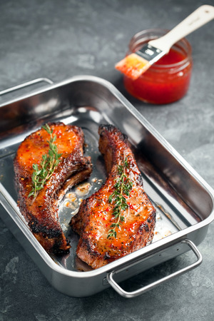 chili sauce: Baked pork with sweet chili sauce, selective focus