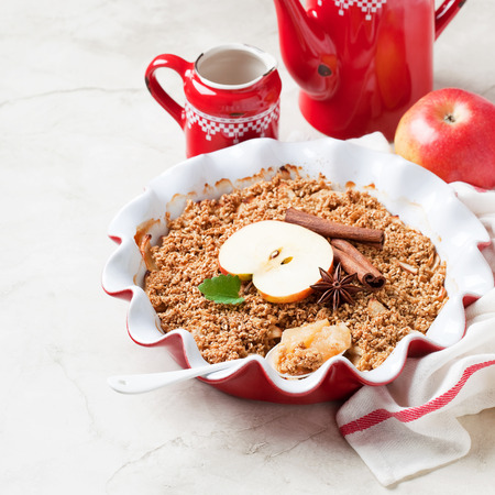 Apple crumble with flax seeds and oat topping, selective focus