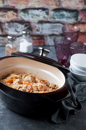 cast iron pan: Traditional Estonian stew with cabbage and barley (Mulgikapsad) in cast iron pan, selective focus