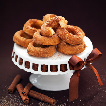 cakestand: Donuts with cinnamon on cakestand; selective focus