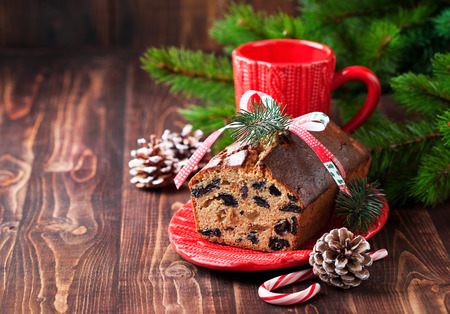 Christmas fruitcake with raisins, selective focus