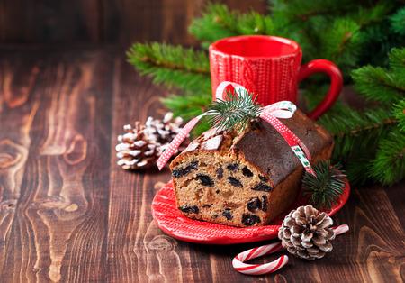 Christmas fruitcake with raisins, selective focus
