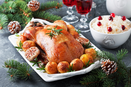 baked potatoes: Christmas roast duck with baked potatoes, selective focus Stock Photo