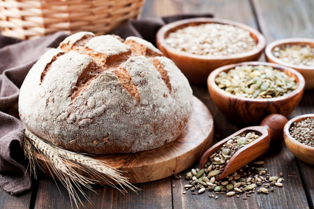 Whole grain bread with seeds of sunflower, pumpkin, flax and hemp, selective focus