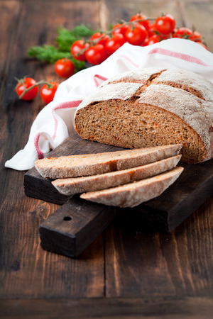 sundried: Homemade whole wheat bread with sundried tomatoes and herbs, selective focus
