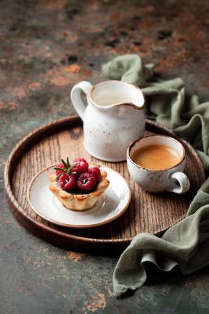 ganache: Tartlets with chocolate ganache and raspberries, selective focus