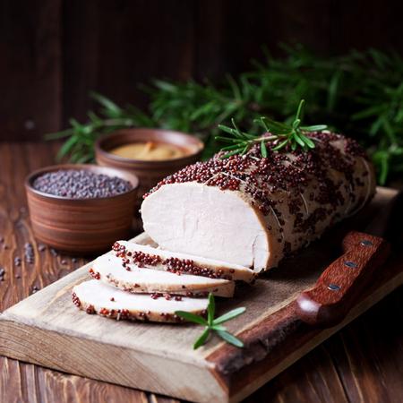 marinade: Roasted pork tenderloin in mustard marinade, selective focus Stock Photo