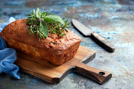 Savoury loaf cake with cheese, peppers and chicken ham, selective focus Stock Photo