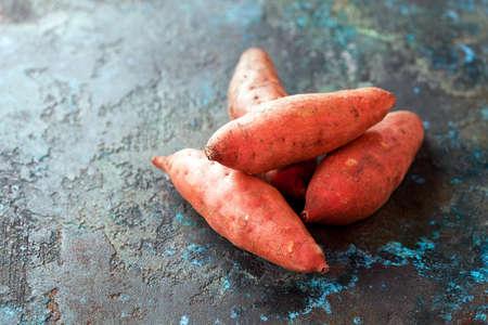 Raw organic sweet potatoes, selective focus