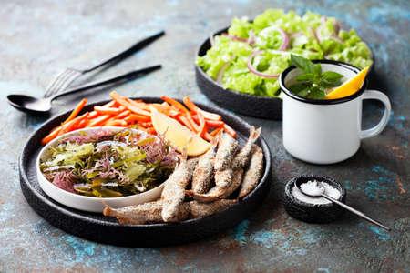 Fried fish capelin, assorted seaweed salad and sweet potato fries, selective focus 版權商用圖片