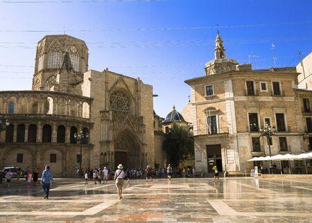Valencia, Spain - 07/21/2019:Basílica de la Virgen de los Desamparados and Valencia Cathedral. La Seu de Valencia on La Plaza De La Virgen - St. Mary Square - Editorial Redakční