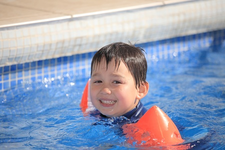 child in the swimming pool photo