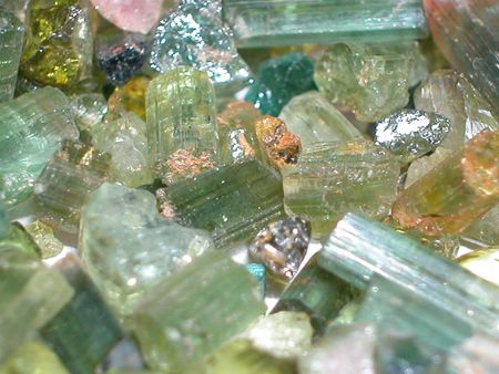 scapolite: Mixed tourmaline rough gemstones Stock Photo