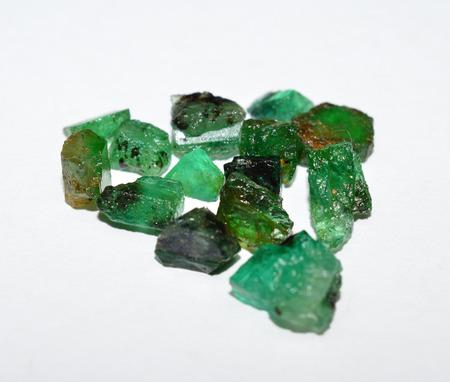 rough diamond: Emerald rough gemstones mixed Stock Photo