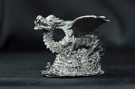 isolatedrn: pewter dragon figurine