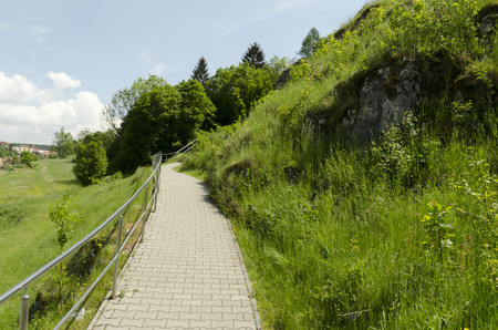 uphill: tiled walkway with handrails uphill