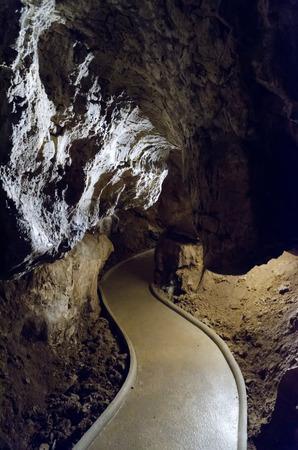sigmoid: concrete walkway in cave
