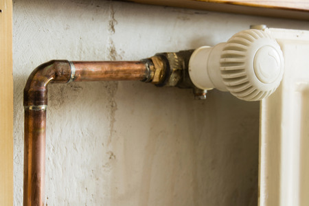 regulating: Copper pipes for heating and regulating valve