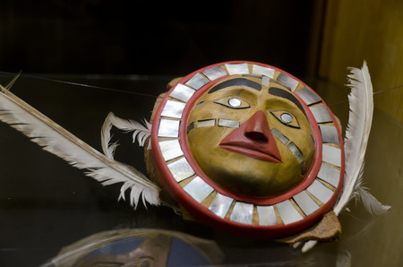 artefacts: Wall mask decorated with bird feathers