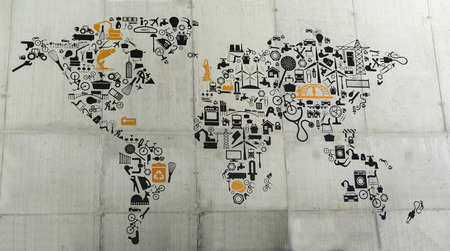 glued: mutated world map on the wall using appliances