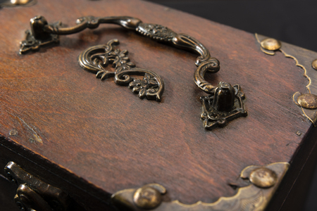 ironwork: Wooden chests decorated with wrought iron handrail and