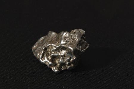 black metallic background: metallic meteorite with a black background Stock Photo