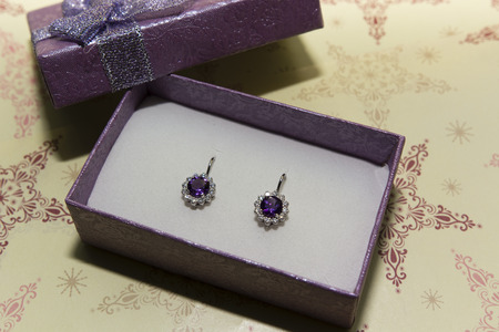 locking up: silver earrings with amethyst and sapphire in a box