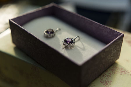 zafiro: silver earrings with amethyst and sapphire in a box